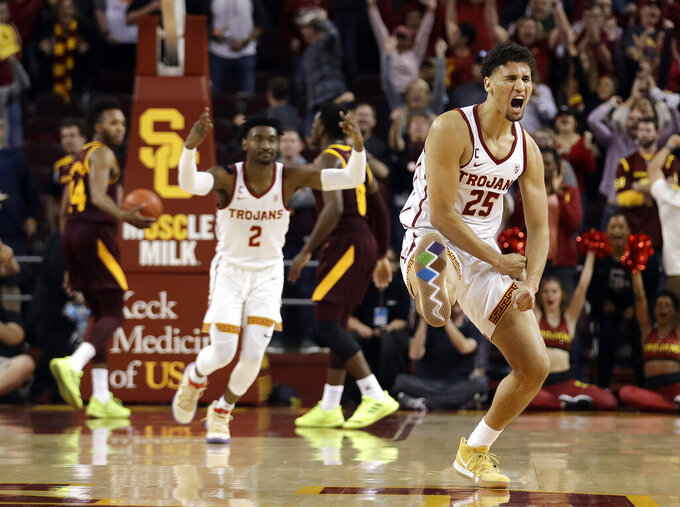 Southern California forward Bennie Boatwright (25) celebrates after making a three-point basket in the closing seconds of a win over Arizona State during the second half of an NCAA college basketball game Saturday, Jan. 26, 2019, in Los Angeles. (AP Photo/Marcio Jose Sanchez)