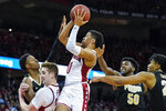 Wisconsin's D'Mitrik Trice (0) shoots between Purdue's Eric Hunter, left, Trevion Williams (50) and Nojel Eastern, right, during the second half of an NCAA college basketball game Tuesday, Feb. 18, 2020, in Madison, Wis. Wisconsin won 69-65. (AP Photo/Andy Manis)