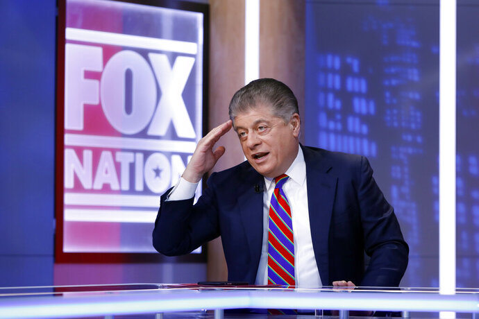 FILE - This Nov. 27, 2018 file photo shows Fox News senior judicial analyst Andrew Napolitano hosting the inaugural broadcast of