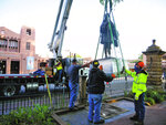 A statue of Spanish territorial governor Don Diego de Vargas is hoisted out of Cathedral Park on Thursday morning, June 18, 2020, in Santa Fe, N.M. Two other markers in the city were slated to come down as monuments to historical figures were being dismantled across the country. (Matt Dahlseid/Santa Fe New Mexican via AP)