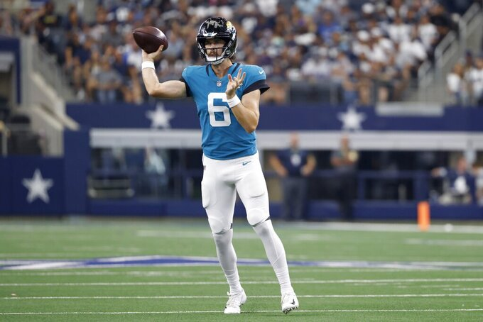 Jacksonville Jaguars quarterback Jake Luton throws a pass in the second half of a preseason NFL football game against the Dallas Cowboys in Arlington, Texas, Sunday, Aug. 29, 2021. (AP Photo/Ron Jenkins)