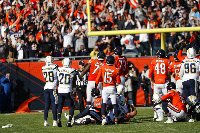 Chicago Bears kicker Eddy Pineiro (15) watches his field goal attempt on the final play of an NFL football game against the Los Angeles Chargers, Sunday, Oct. 27, 2019, in Chicago. Pineiro missed the field goal as the Chargers won 17-16. (AP Photo/Charles Rex Arbogast)