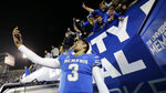 Memphis quarterback Brady White takes a selfie with a fan's phone after the team's NCAA college football game against SMU on Saturday, Nov. 2, 2019, in Memphis, Tenn. Memphis won 54-48. (AP Photo/Mark Humphrey)