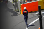 Red Bull driver Max Verstappen of the Netherlands walks off the track after his car hit a wall during the third free practice session at the Baku Formula One city circuit in Baku, Azerbaijan, Saturday, June 5, 2021. The Azerbaijan Formula One Grand Prix will take place on Sunday. (AP Photo/Darko Vojinovic)
