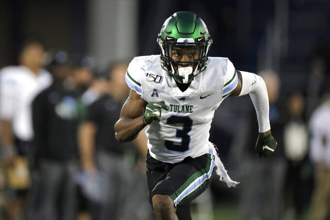 FILE - In this Oct. 26, 2019, file photo, Tulane wide receiver Darnell Mooney runs a route against Navy during the second half of an NCAA college football game in Annapolis. The Chicago Bears selected Mooney in the fifth round of the NFL football draft on Saturday, April 25, 2020. (AP Photo/Julio Cortez, File)