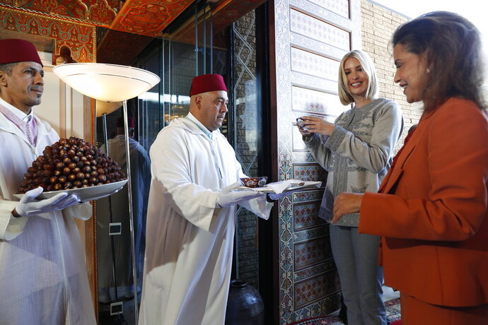 Ivanka Trump, the daughter and senior adviser to President Donald Trump, is greeted by Princess Lalla Meryem of Morocco and is offered dates and milk, as she arrives in Rabat, Morocco, Wednesday, Nov. 6, 2019, where she will promote a global economical program for women. (AP Photo/Jacquelyn Martin)