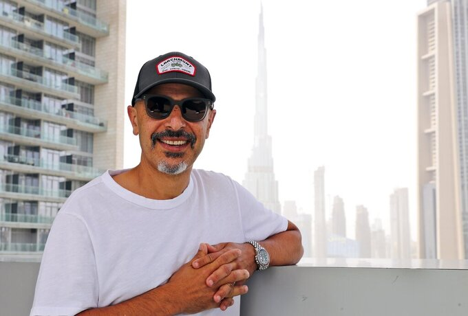 Stand-up comedian Maz Jobrani poses in Dubai, United Arab Emirates, Tuesday, May 25, 2021. For Iranian-American Maz Jobrani, a stand-up show in Dubai marked the first time he's been in front of a major live audience overseas since the start of the coronavirus pandemic and he feels it. (AP Photo/Kamran Jebreili)