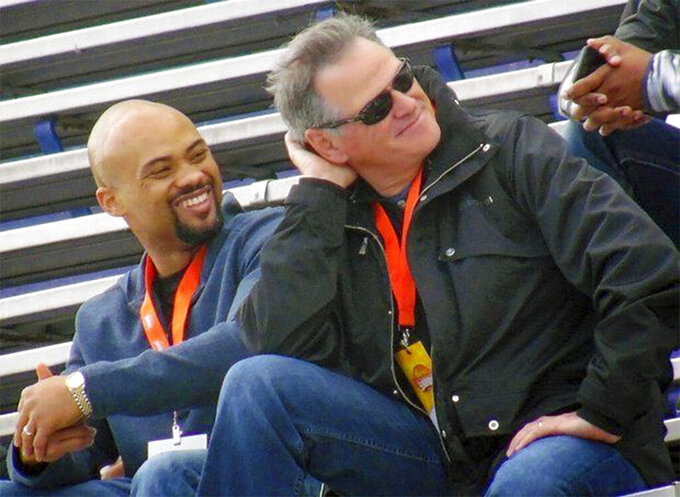 Terry Fontenot, left, and New Orleans Saints general manager Mickey Loomis watch Senior Bowl practice in Mobile, Ala., in this Jan. 20, 2015, photo. The Atlanta Falcons have named Terry Fontenot the team's general manager. The 40-year-old Fontenot becomes Atlanta's first Black general manager after spending 16 seasons with division rival New Orleans. (Evan Woodbery/The Times-Picayune/The New Orleans Advocate via AP)