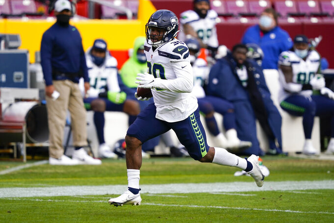 Seattle Seahawks running back Carlos Hyde (30) carries the ball during his 50-yard touchdown run against the Washington Football Team, Sunday, Dec. 20, 2020, in Landover, Md. (AP Photo/Susan Walsh)