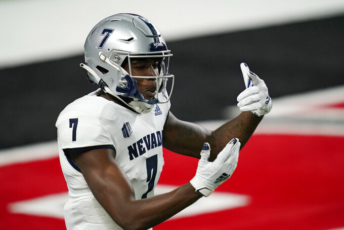 Nevada wide receiver Romeo Doubs (7) celebrates after scoring a touchdown against UNLV during the first half of an NCAA college football game Saturday, Oct. 31, 2020, in Las Vegas. (AP Photo/John Locher)