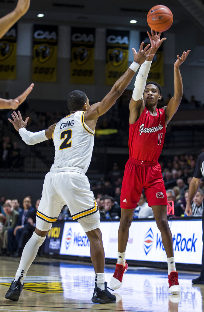 Jacksonville State guard Elias Harden (13) shoots as Virginia Commonwealth guard Marcus Evans (2) plays defense during the first half of an NCAA college basketball game Sunday, Nov. 17, 2019 in Richmond, Va. (AP Photo/Zach Gibson)