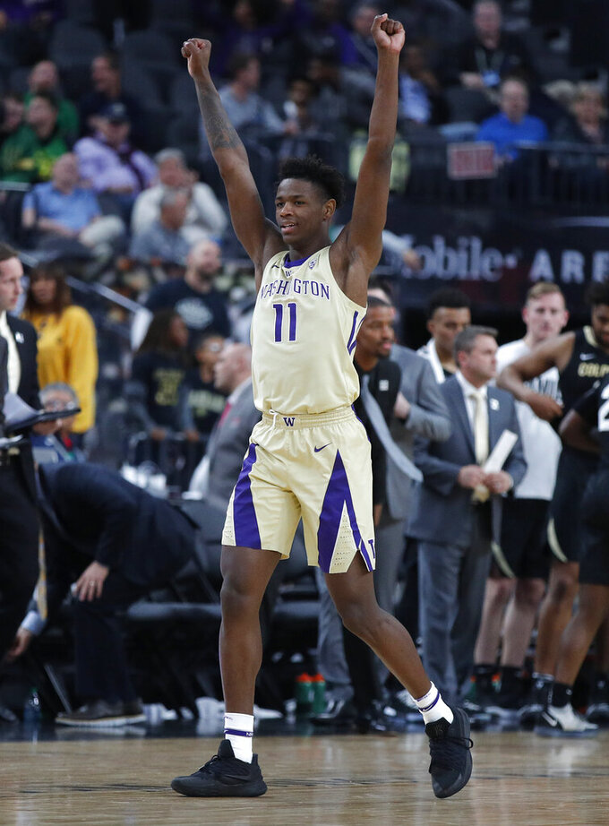 Washington's Nahziah Carter celebrates after his team defeated Colorado during the second half of an NCAA college basketball game in the semifinals of the Pac-12 men's tournament Friday, March 15, 2019, in Las Vegas. (AP Photo/John Locher)