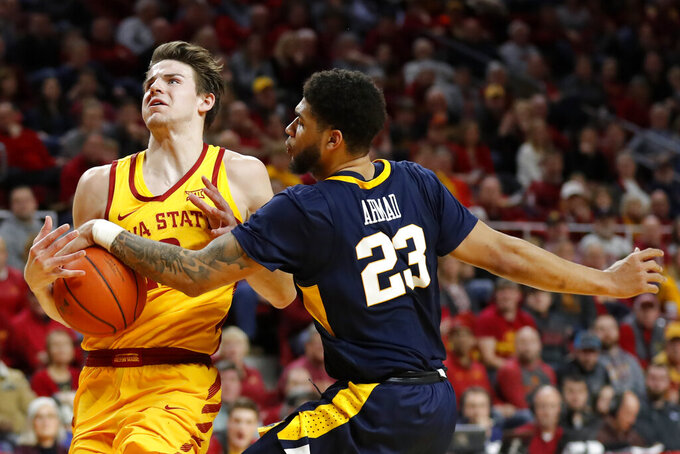 Iowa State forward Michael Jacobson is fouled by West Virginia forward Esa Ahmad (23) while driving to the basket during the second half of an NCAA college basketball game Wednesday, Jan. 30, 2019, in Ames, Iowa. Iowa State won 93-68. (AP Photo/Charlie Neibergall)