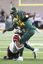 Baylor wide receiver Chris Platt, right, is tackled after the catch by Oklahoma cornerback Tre Brown, left, during the first half of an NCAA college football game in Waco, Texas, Saturday, Nov. 16, 2019. (AP Photo/Ray Carlin)