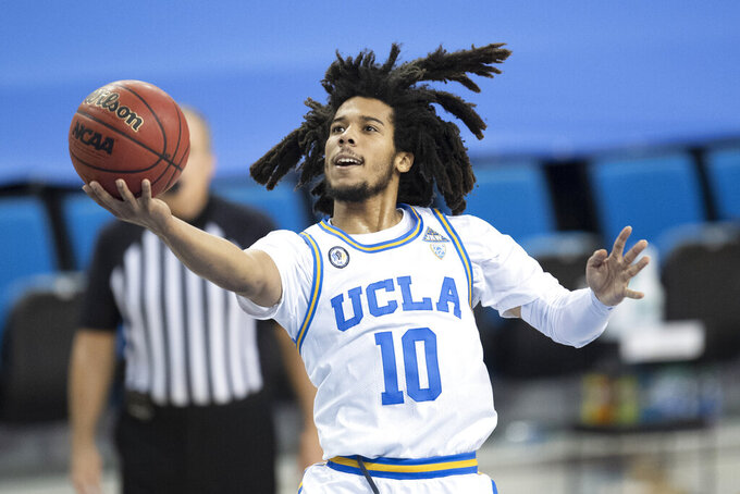 UCLA guard Tyger Campbell goes up for a basket during the second half of an NCAA college basketball game against California, Sunday, Dec. 6, 2020, in Los Angeles. (AP Photo/Kyusung Gong)