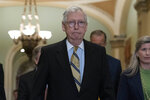 Senate Minority Leader Mitch McConnell, R-Ky., walks to speak with the press after a GOP policy luncheon, on Capitol Hill i on Capitol Hill in Washington, Tuesday, July 20, 2021. (AP Photo/Jose Luis Magana)