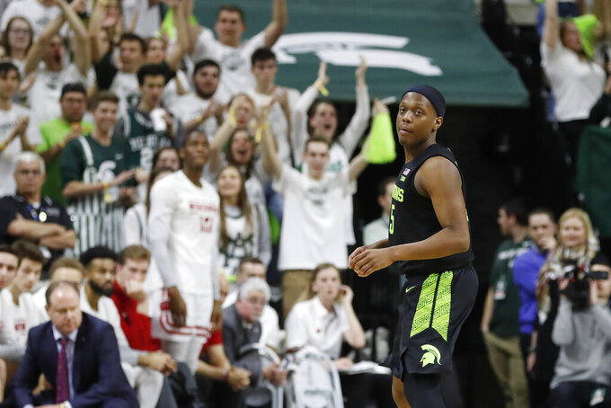 Fans cheer after Michigan State guard Cassius Winston attained the all-time Big Ten and Michigan State records for assists during the second half of an NCAA college basketball game against Wisconsin, Friday, Jan. 17, 2020, in East Lansing, Mich. (AP Photo/Carlos Osorio)