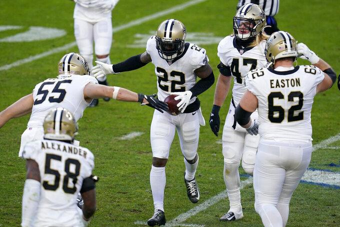 New Orleans Saints safety Chauncey Gardner-Johnson (22) celebrates his interception against the Denver Broncos during the second half of an NFL football game, Sunday, Nov. 29, 2020, in Denver. (AP Photo/David Zalubowski)