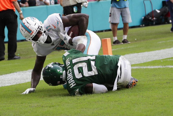 Miami Dolphins wide receiver DeVante Parker (11) scores a touchdown against New York Jets cornerback Nate Hairston (21) during the first half of an NFL football game, Sunday, Nov. 3, 2019, in Miami Gardens, Fla. (AP Photo/Lynne Sladky)