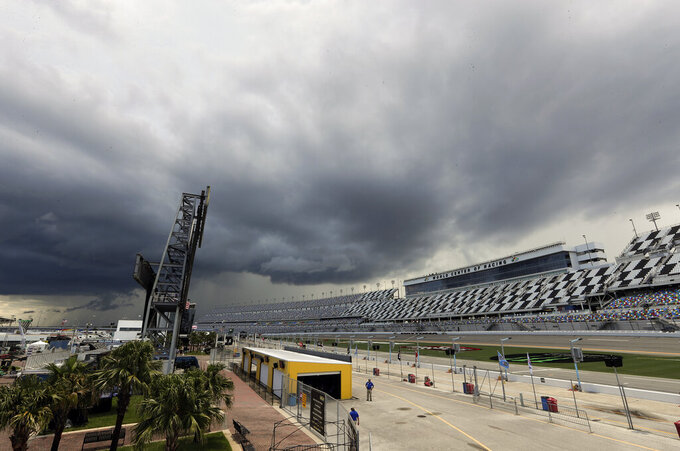 Storm clouds move over Daytona International Speedway causing a delay of events before a NASCAR Xfinity auto race, Friday, July 5, 2019, in Daytona Beach, Fla. (AP Photo/John Raoux)