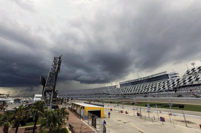 Storm clouds move over Daytona International Speedway causing a delay of events before a NASCAR Xfinity auto race, Friday, July 5, 2019, in Daytona Beach, Fla. (AP Photo/John Raoux)
