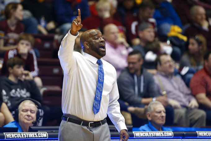 Hampton head coach Edward Joyner, Jr. directs his team against Winthrop during the first half of an NCAA college basketball game for the Big South tournament championship in Rock Hill, S.C., Sunday, March 8, 2020. (AP Photo/Nell Redmond)