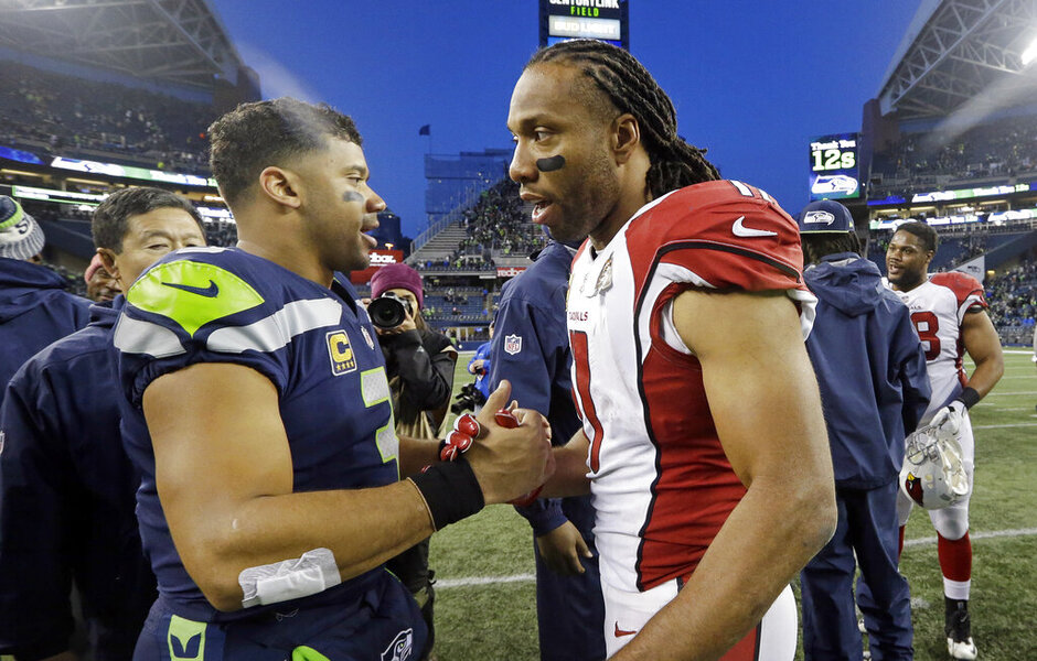 Russell Wilson, Larry Fitzgerald