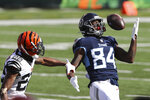 Tennessee Titans' Corey Davis (84) is defended by Cincinnati Bengals' William Jackson (22) during the first half of an NFL football game, Sunday, Nov. 1, 2020, in Cincinnati. (AP Photo/Jay LaPrete)
