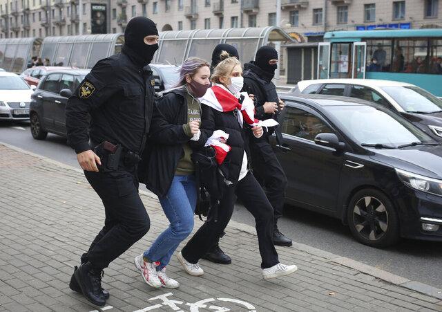 Police detain women during an opposition rally to protest the official presidential election results in Minsk, Belarus, Saturday, Oct. 17, 2020. Police in Belarus on Saturday detained scores of demonstrators pushing for the resignation of the country's authoritarian leader after an August election widely seen as manipulated. (AP Photo)