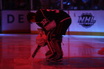 Los Angeles Kings goaltender Jonathan Quick (32) listens to the national anthem before the start of an NHL hockey game against the Minnesota Wild Tuesday, Nov. 12, 2019, in Los Angeles. (AP Photo/Marcio Jose Sanchez)