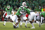 North Texas linebacker KD Davis (23) and defensive back Deshawn Gaddie (17) attempt to take down Houston wide receiver Bryson Smith (1) during the first half of an NCAA college football game on Saturday, Sept. 28, 2019, in Denton, Texas.  (Kara Dry/The Denton Record-Chronicle via AP)