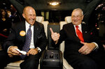 FILE - In this Oct. 18, 2005, file photo, Mercedes-Benz of Beverly Hills general manager Stephen Smythe, left, and Lee Iacocca joke in the back of the new 12-cylinder Maybach 57 S, as the car unveiled at the Mercedes-Benz of Beverly Hills dealership in Beverly Hills, Calif. Iacocca, the auto executive and master pitchman who put the Mustang in Ford's lineup in the 1960s and became a corporate folk hero when he resurrected Chrysler 20 years later, has died in Bel Air, California. He was 94. Two former Chrysler executives who worked with Iacocca were told of his death Tuesday, July 2, 2019. (AP Photo/Damian Dovarganes, File)