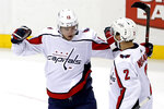 Washington Capitals' Jakub Vrana (13) celebrates his goal with Matt Niskanen during the first period of an NHL hockey game against the Pittsburgh Penguins in Pittsburgh, Tuesday, March 12, 2019. (AP Photo/Gene J. Puskar)