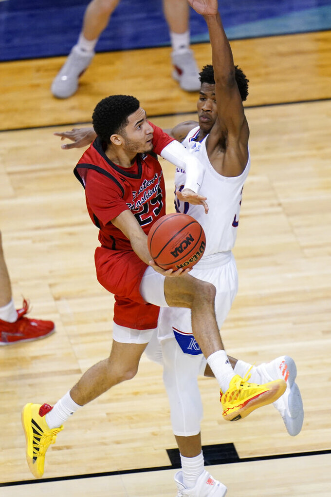 Eastern Washington guard Michael Meadows (25) drives to the basket as Kansas guard Ochai Agbaji, right, defends during the second half of a first-round game in the NCAA college basketball tournament at Farmers Coliseum in Indianapolis, Saturday, March 20, 2021. (AP Photo/AJ Mast)