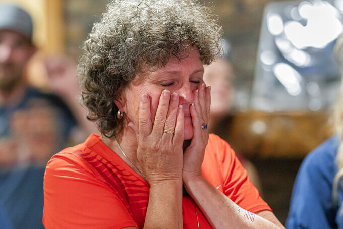 Lisa Crouser reacts Wednesday, Aug. 4, 2021, in Redmond, Ore., as her son Ryan Crouser wins the gold medal in the shot put at the Tokyo Olympics. (AP Photo/Nathan Howard)