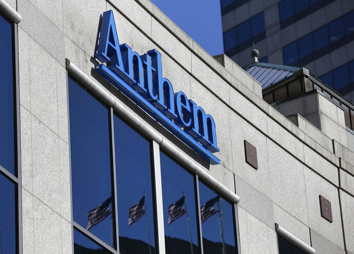 FILE - In this Feb. 5, 2015, file photo, the Anthem logo hangs at the health insurer's corporate headquarters in Indianapolis. Anthem Inc., reports earnings Wednesday, April 24, 2019. (AP Photo/Michael Conroy, File)