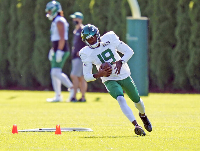 FILE - In this Thursday, Aug. 20, 2020 file photo, New York Jets' Breshad Perriman participates during practice at the NFL football team's training camp in Florham Park, N.J.  The New York Jets are getting healthy again at just the right time. Wide receivers Breshad Perriman and Denzel Mims practiced fully Wednesday, Sept. 9, 2020 and are expected to be healthy for the season opener against the Bills in Buffalo on Sunday. (AP Photo/Seth Wenig, File)