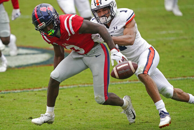 Mississippi linebacker Lakia Henry (0) breaks up a pass intended for Auburn wide receiver Anthony Schwartz (1) during the second half of an NCAA college football game in Oxford, Miss., Saturday, Oct. 24, 2020. (AP Photo/Rogelio V. Solis)