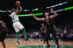 Boston Celtics guard Kemba Walker (8) shoots over Cleveland Cavaliers forward Kevin Love (0) during the second half of an NBA basketball game in Boston, Monday, Dec. 9, 2019. The Celtics won 110-88. (AP Photo/Charles Krupa)