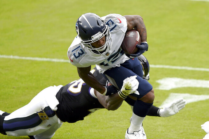Tennessee Titans wide receiver Cameron Batson (13) is hit by Baltimore Ravens inside linebacker Patrick Queen during the first half of an NFL football game, Sunday, Nov. 22, 2020, in Baltimore. (AP Photo/Gail Burton)