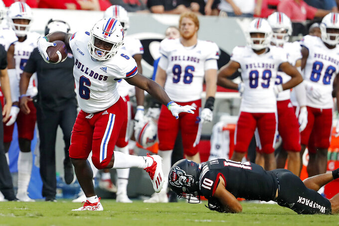 Louisiana Tech's Smoke Harris (6) breaks away from North Carolina State's Tanner Ingle (10) during the first half of an NCAA college football game in Raleigh, N.C., Saturday, Oct. 2, 2021. (AP Photo/Karl B DeBlaker)