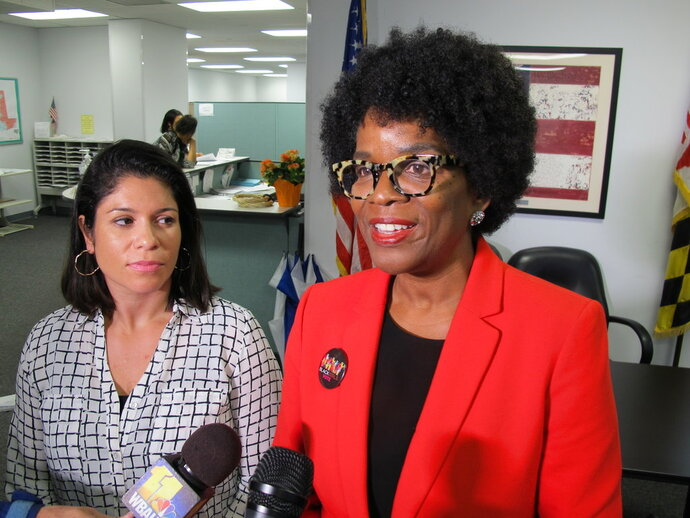 Valerie Ervin, right, announces her bid to run for governor on Thursday, May 17, 2018 at the Maryland State Board of Elections in Annapolis, Md.  Ervin was the running mate of Kevin Kamenetz, a Maryland gubernatorial candidate who died suddenly last week.   Ervin chose Marisol Johnson, left, as her running mate, describing her as an immigrant from El Salvador who owns a small business, was a former Baltimore County school board member, and is a mother of four.  (AP Photo/Brian Witte)