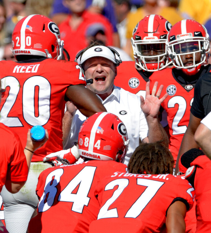 Georgia coach Kirby Smart talks to his players during the first half of an NCAA college football game against LSU in Baton Rouge, La., Saturday, Oct. 13, 2018. (AP Photo/Matthew Hinton)