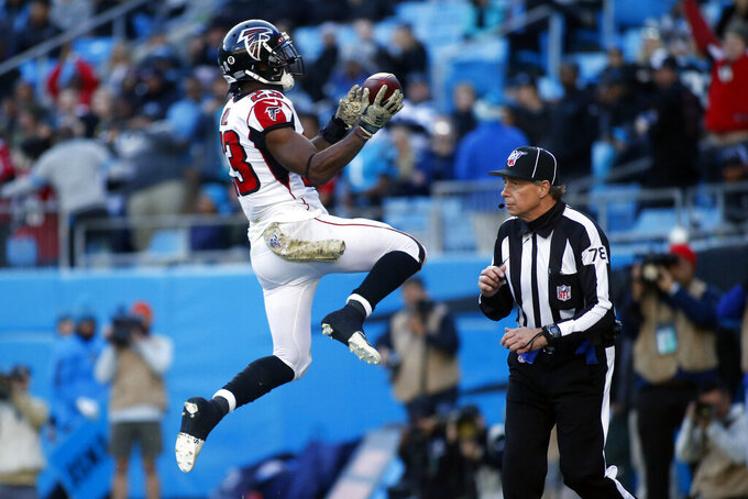 Atlanta Falcons running back Brian Hill (23) celebrates his touchdown against the Carolina Panthers during the second half of an NFL football game in Charlotte, N.C., Sunday, Nov. 17, 2019. (AP Photo/Brian Blanco)