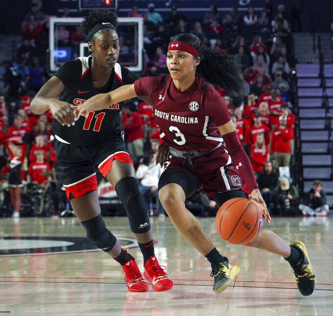 South Carolina guard Destanni Henderson, right, drives around Georgia guard Maya Caldwell during the second half of an NCAA college basketball game Sunday, Jan. 26, 2020, in Athens, Ga. (AP Photo/Tami Chappell)