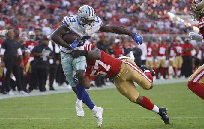 Dallas Cowboys wide receiver Michael Gallup (13) is tackled by San Francisco 49ers linebacker Dre Greenlaw during the first half of an NFL preseason football game in Santa Clara, Calif., Saturday, Aug. 10, 2019. (AP Photo/Jeff Chiu)