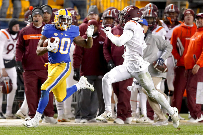 Pittsburgh running back Qadree Ollison (30) looks back at Virginia Tech defensive back Caleb Farley (3) as he makes a 97-yard-run for a touchdown in the fourth quarter of an NCAA football game, Saturday, Nov. 10, 2018, in Pittsburgh. Pittsburgh won 52-22.(AP Photo/Keith Srakocic)