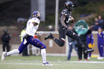 Cincinnati wide receiver Malick Mbodj (80) runs after making a catch as East Carolina defensive back Daniel Charles (27) closes in during an NCAA college football game, Friday, Nov. 23, 2018, in Cincinnati.   (Kareem Elgazzar/The Cincinnati Enquirer via AP)