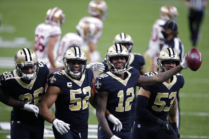 New Orleans Saints wide receiver Marquez Callaway (12) celebrates his recovery of a muffed punt with linebacker Craig Robertson (52), linebacker Zack Baun (53) and cornerback P.J. Williams (26) in the second half of an NFL football game against the San Francisco 49ers in New Orleans, Sunday, Nov. 15, 2020. (AP Photo/Butch Dill)