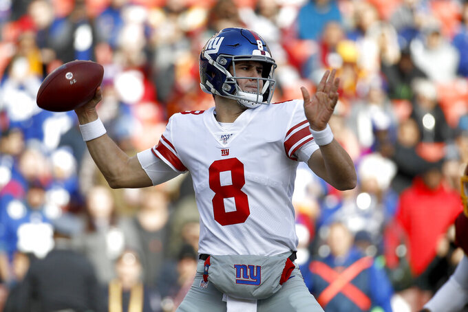 New York Giants quarterback Daniel Jones looks to pass against the Washington Redskins during the first half of an NFL football game, Sunday, Dec. 22, 2019, in Landover, Md. (AP Photo/Patrick Semansky)